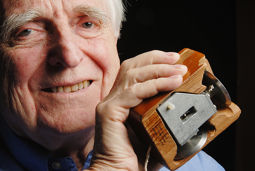 Douglas Engelbart with his archaic computer mouse at hand