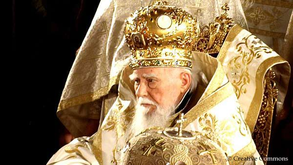 Patriarch Maxim sitting Patriarchate throne and with patriarch crown and scepter
