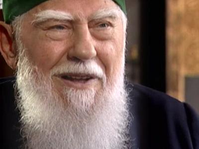 Patriarch Maxim smilng