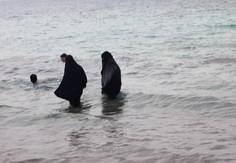 Arab woman swimming in Burkas in Arab Sea, United Arab Emirates