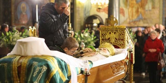Tiny Bulgarian kid venerating patriarch Maxim's body in st. Nedelia Church - Patriarch Maxim's Opelo
