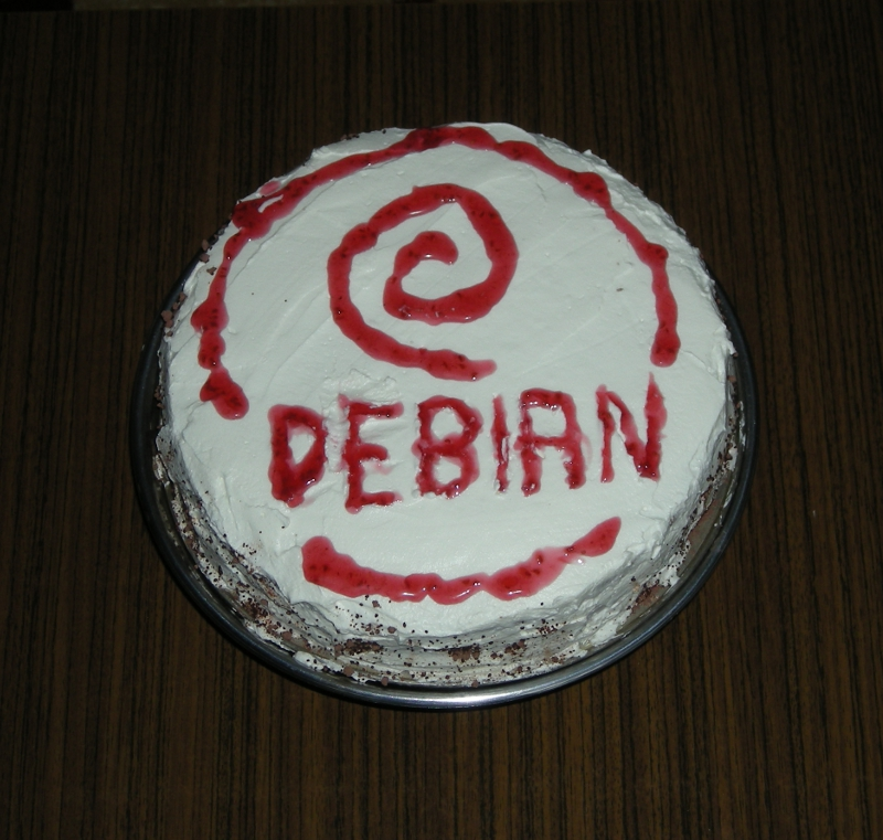 Debian Happy birthday cake with debian logo spiral - Debian Linux becomes 20 years old