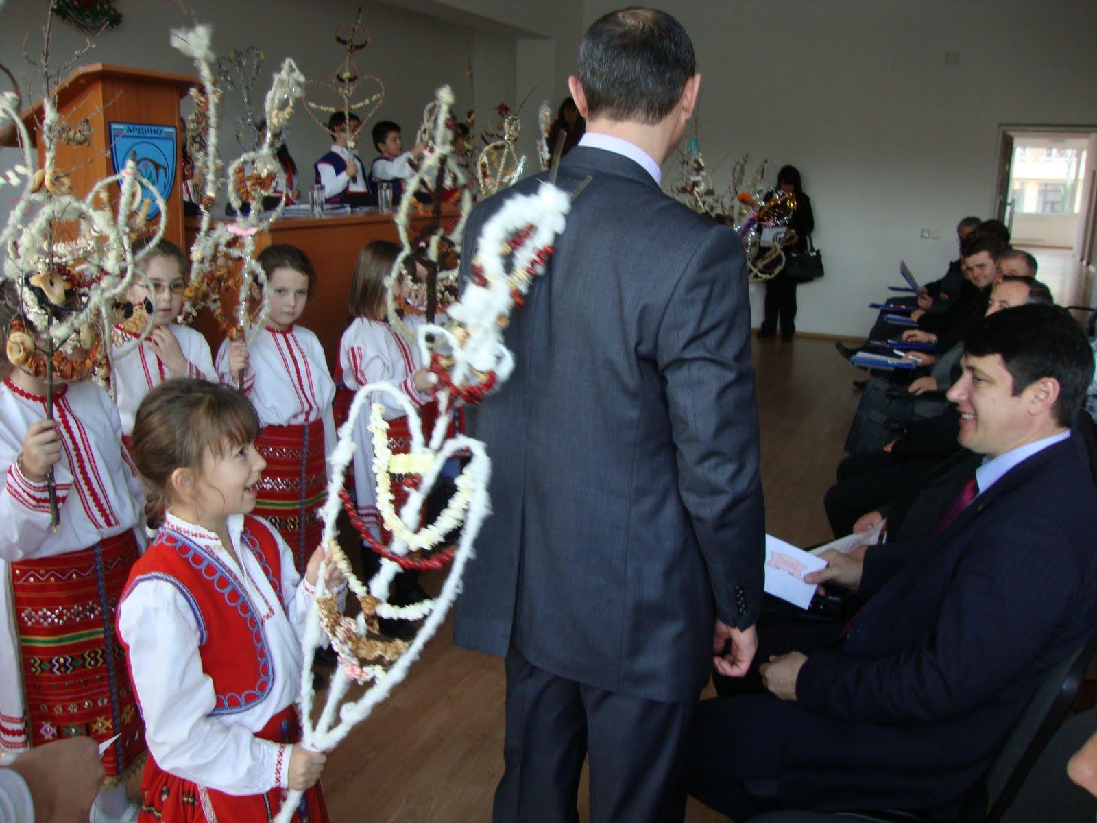 Surva Surva Godina, Vesela Godina kid back tapping an older man Bulgaria