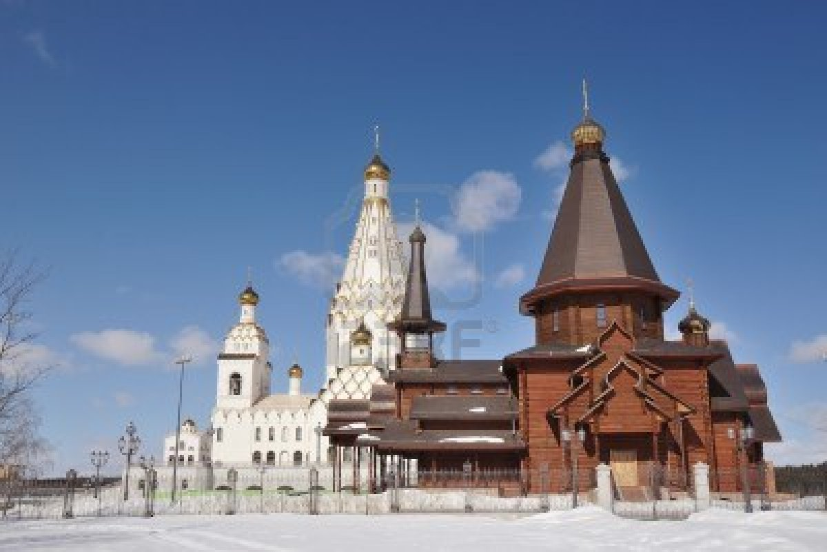 orthodox church All saints cHRISTIAN church in construction Minsk Belarus and wooden orthodox church